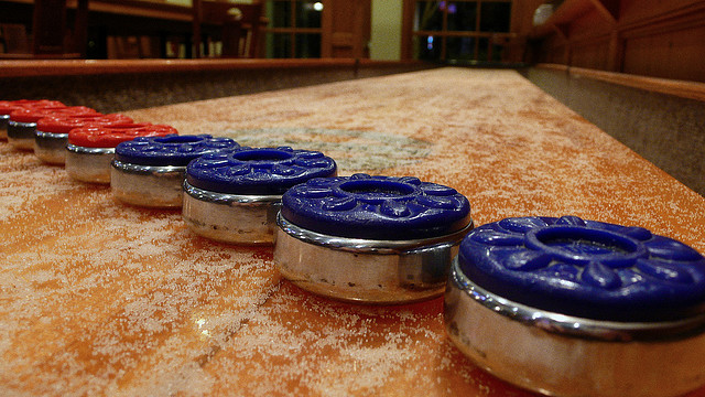Shuffleboard pucks on a table