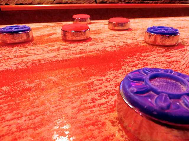 Shuffleboard table pucks close up